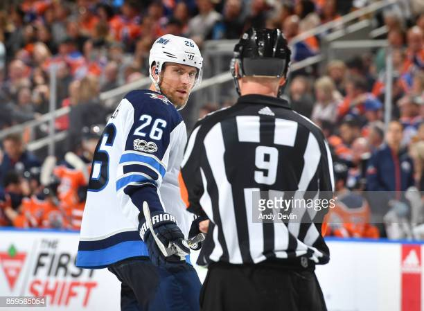 Blake Wheeler of the Winnipeg Jets discusses the play with Dan O'Rourke during the game against the Edmonton Oilers on October 9 2017 at Rogers Place...