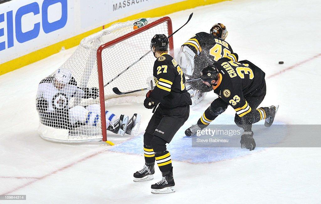 Blake Wheeler #26 of the Winnipeg Jets falls into the net against the Boston Bruins at the TD Garden on January 21, 2013 in Boston, Massachusetts.