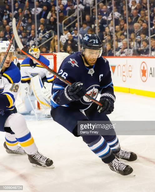 Blake Wheeler of the Winnipeg Jets follows the play around the boards during third period action against the St Louis Blues at the Bell MTS Place on...