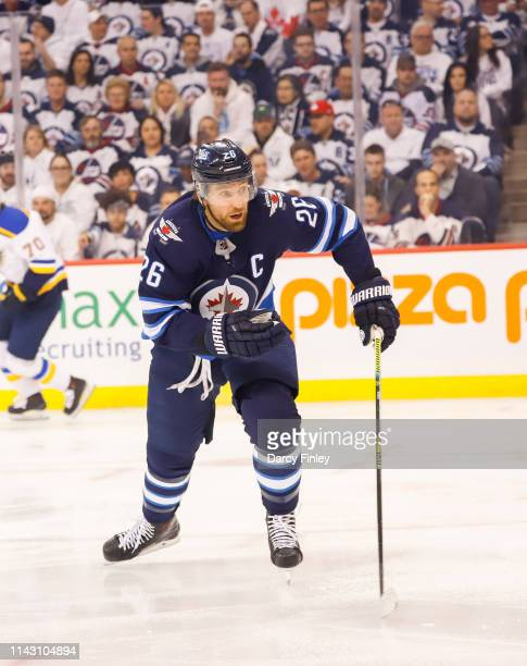 Blake Wheeler of the Winnipeg Jets follows the play down the ice during first period action against the St Louis Blues in Game Two of the Western...
