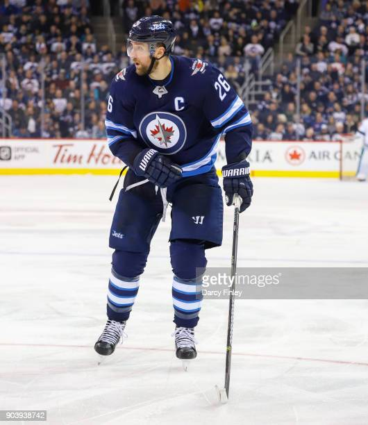 Blake Wheeler of the Winnipeg Jets follows the play down the ice during third period action against the San Jose Sharks at the Bell MTS Place on...