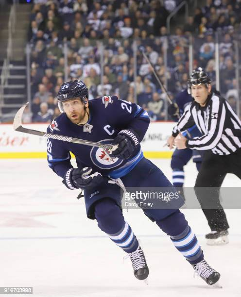 Blake Wheeler of the Winnipeg Jets follows the play down the ice during second period action against the Arizona Coyotes at the Bell MTS Place on...