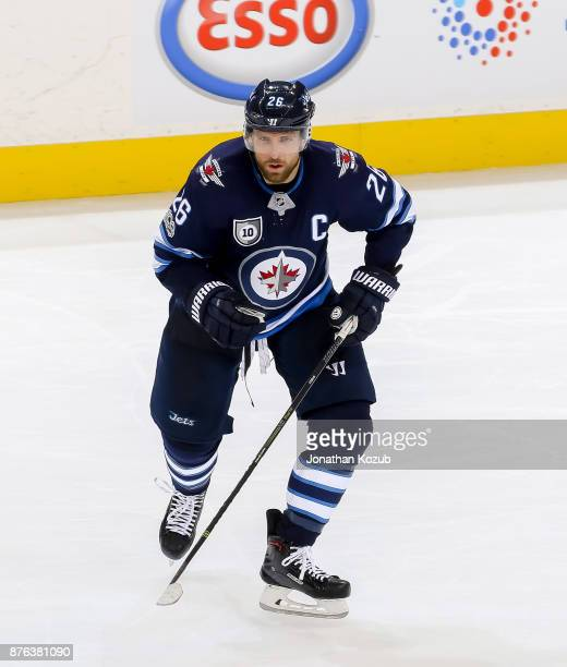 Blake Wheeler of the Winnipeg Jets follows the play up the ice during third period action against the Arizona Coyotes at the Bell MTS Place on...