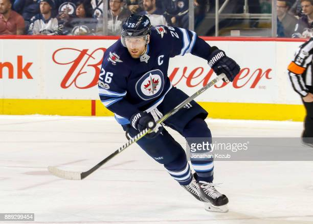 Blake Wheeler of the Winnipeg Jets follows the play up the ice during second period action against the Ottawa Senators at the Bell MTS Place on...