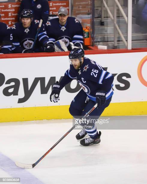 Blake Wheeler of the Winnipeg Jets follows the play up the ice during first period action against the Los Angeles Kings at the Bell MTS Place on...
