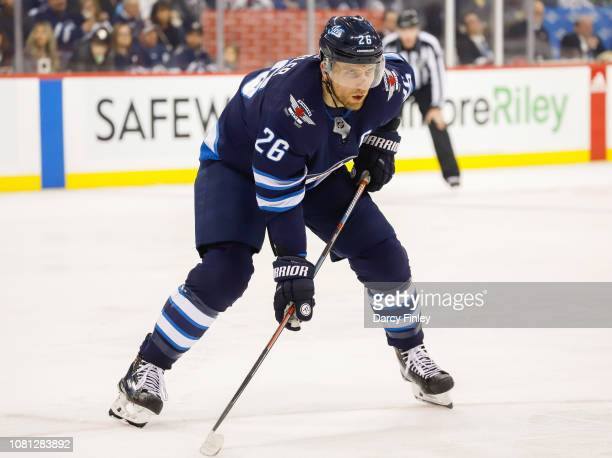 Blake Wheeler of the Winnipeg Jets gets set during a second period faceoff against the Philadelphia Flyers at the Bell MTS Place on December 9 2018...
