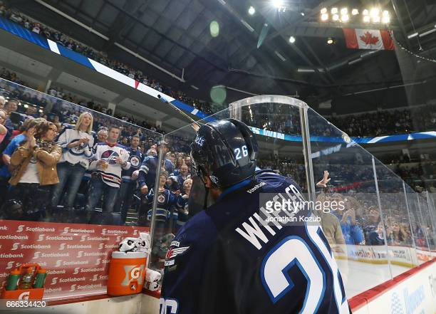 Blake Wheeler of the Winnipeg Jets gives his stick to a fan following a 21 victory over the Nashville Predators at the MTS Centre on April 8 2017 in...