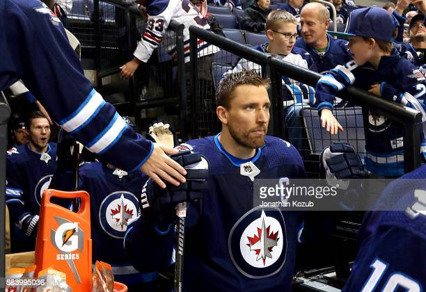 Blake Wheeler of the Winnipeg Jets heads to the ice for the start of the pregame warm up prior to NHL action against the Vegas Golden Knights at the...