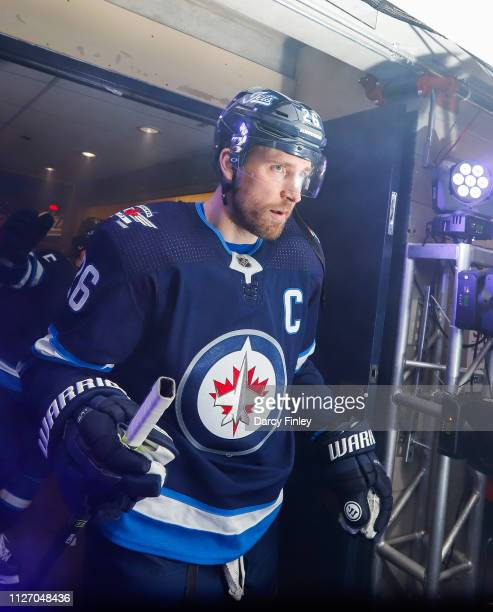 Blake Wheeler of the Winnipeg Jets heads to the ice prior to NHL action against the Columbus Blue Jackets at the Bell MTS Place on January 31 2019 in...