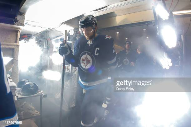 Blake Wheeler of the Winnipeg Jets heads to the ice prior to puck drop against the St Louis Blues in Game Five of the Western Conference First Round...