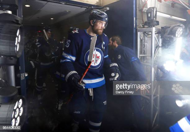Blake Wheeler of the Winnipeg Jets heads to the ice prior to the start of NHL action against the Nashville Predators in Game Four of the Western...