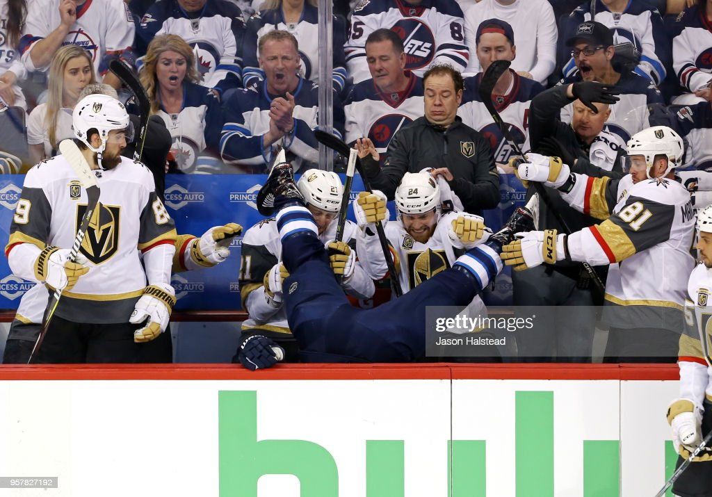 Blake Wheeler #26 of the Winnipeg Jets is checked into the Vegas Golden Knights bench during the first period in Game One of the Western Conference Finals during the 2018 NHL Stanley Cup Playoffs at Bell MTS Place on May 12, 2018 in Winnipeg, Canada.