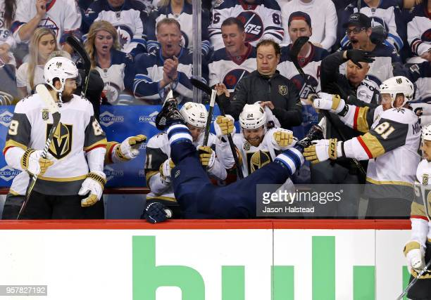 Blake Wheeler of the Winnipeg Jets is checked into the Vegas Golden Knights bench during the first period in Game One of the Western Conference...