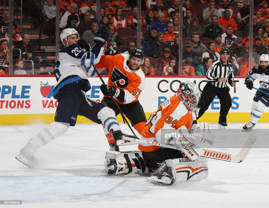 Blake Wheeler #26 of the Winnipeg Jets is stopped by Andrew MacDonald #47 and Petr Mrazek #34 of the Philadelphia Flyers during the third period at the Wells Fargo Center on March 10, 2018 in Philadelphia, Pennsylvania. The Flyers defeated the Jets 2-1.