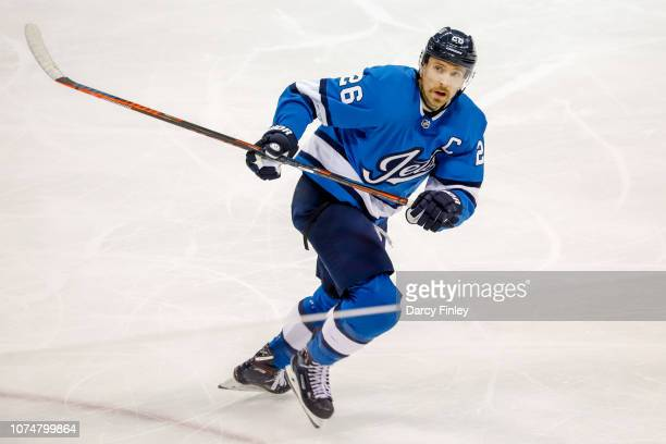 Blake Wheeler of the Winnipeg Jets keeps an eye on the play during first period action against the Pittsburgh Penguins at the Bell MTS Place on...