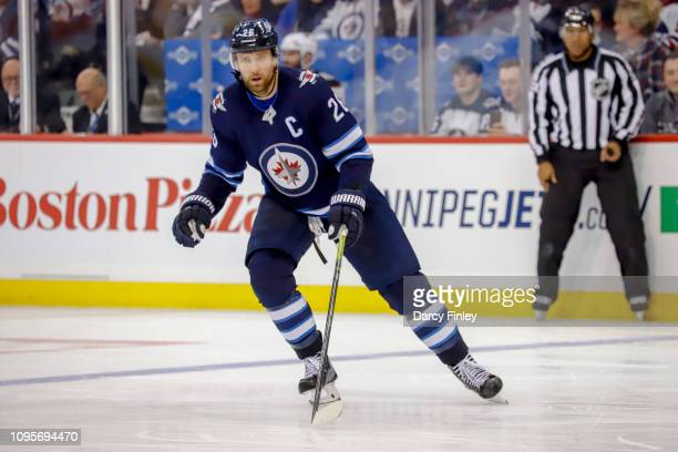 Blake Wheeler of the Winnipeg Jets keeps an eye on the play during third period action against the Anaheim Ducks at the Bell MTS Place on January 13...