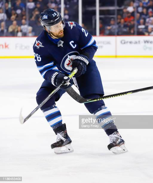 Blake Wheeler of the Winnipeg Jets keeps an eye on the play during third period action against the Boston Bruins at the Bell MTS Place on March 14...