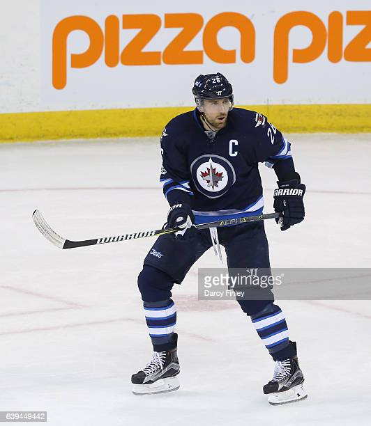 Blake Wheeler of the Winnipeg Jets keeps an eye on the play during second period action against the Arizona Coyotes at the MTS Centre on January 18...