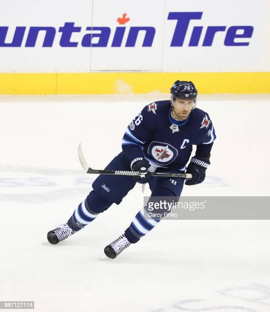 Blake Wheeler of the Winnipeg Jets keeps an eye on the play during second period action against the Vegas Golden Knights at the Bell MTS Place on...