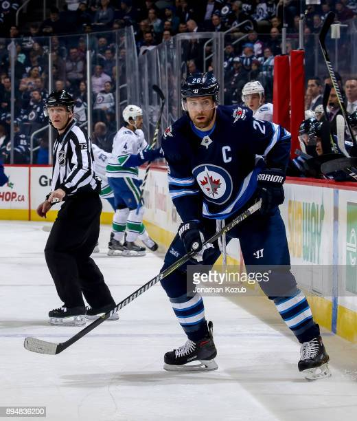 Blake Wheeler of the Winnipeg Jets keeps an eye on the play during first period action against the Vancouver Canucks at the Bell MTS Place on...