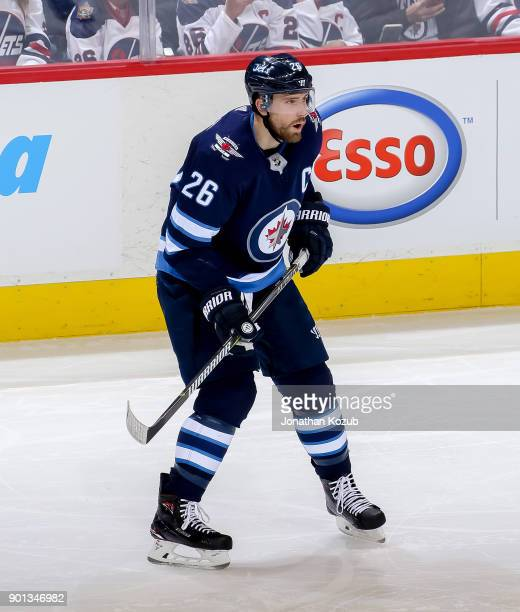 Blake Wheeler of the Winnipeg Jets keeps an eye on the play during second period action against the New York Islanders at the Bell MTS Place on...