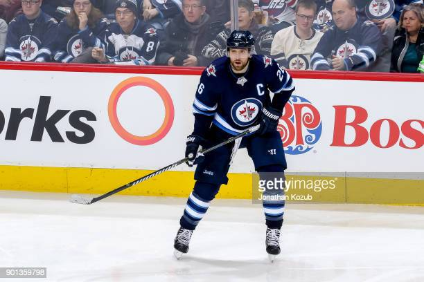 Blake Wheeler of the Winnipeg Jets keeps an eye on the play during third period action against the New York Islanders at the Bell MTS Place on...