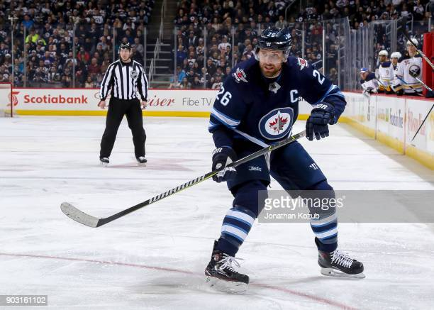 Blake Wheeler of the Winnipeg Jets keeps an eye on the play during second period action against the Buffalo Sabres at the Bell MTS Place on January 5...