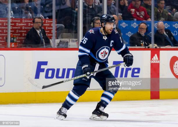 Blake Wheeler of the Winnipeg Jets keeps an eye on the play during first period action against the Arizona Coyotes at the Bell MTS Place on February...