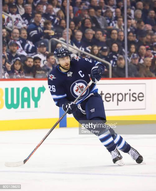 Blake Wheeler of the Winnipeg Jets keeps an eye on the play during second period action against the Washington Capitals at the Bell MTS Place on...
