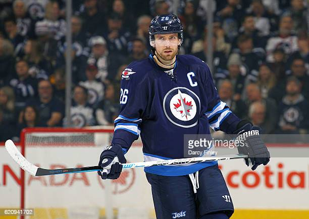 Blake Wheeler of the Winnipeg Jets looks on during a first period stoppage in play against the Buffalo Sabres at the MTS Centre on October 30 2016 in...