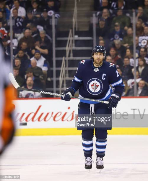 Blake Wheeler of the Winnipeg Jets looks on during a second period stoppage in play against the Arizona Coyotes at the Bell MTS Place on February 6...