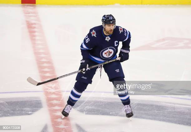 Blake Wheeler of the Winnipeg Jets looks on during first period action against the Edmonton Oilers at the Bell MTS Place on December 27 2017 in...