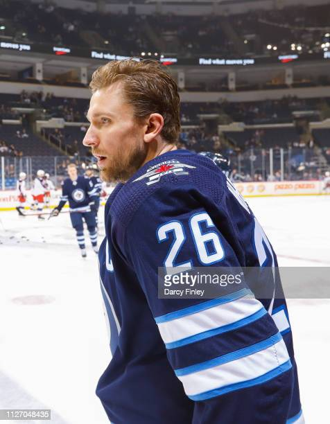 Blake Wheeler of the Winnipeg Jets looks on during the pregame warm up prior to NHL action against the Columbus Blue Jackets at the Bell MTS Place on...