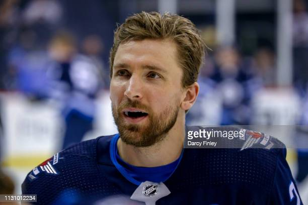 Blake Wheeler of the Winnipeg Jets looks on during the pregame warm up prior to NHL action against the Ottawa Senators at the Bell MTS Place on...