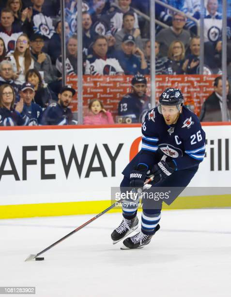 Blake Wheeler of the Winnipeg Jets plays the puck down the ice during second period action against the Philadelphia Flyers at the Bell MTS Place on...