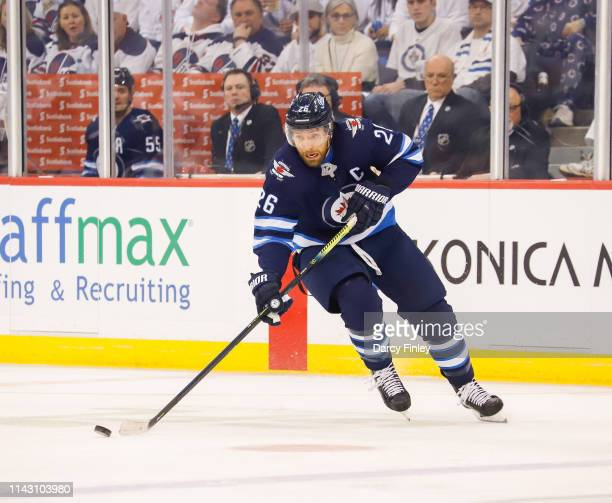 Blake Wheeler of the Winnipeg Jets plays the puck down the ice during first period action against the St Louis Blues in Game Two of the Western...