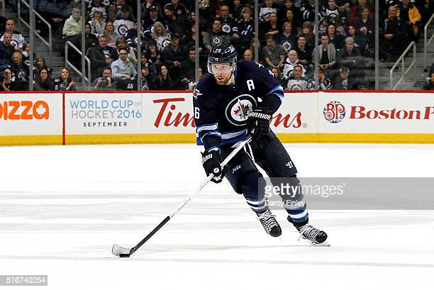 Blake Wheeler of the Winnipeg Jets plays the puck down the ice during the overtime period against the Anaheim Ducks at the MTS Centre on March 20...