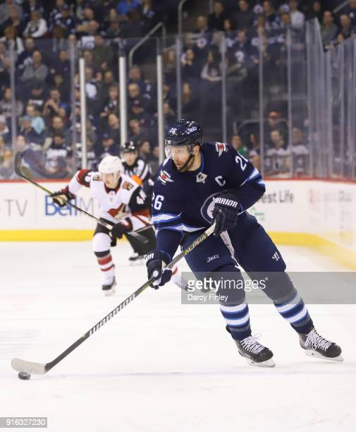Blake Wheeler of the Winnipeg Jets plays the puck down the ice during first period action against the Arizona Coyotes at the Bell MTS Place on...
