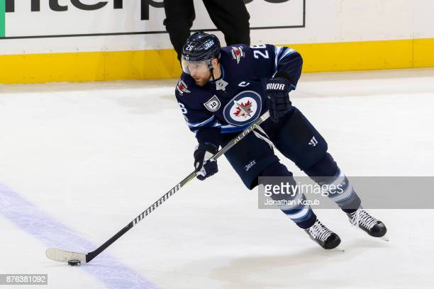 Blake Wheeler of the Winnipeg Jets plays the puck up the ice during third period action against the Arizona Coyotes at the Bell MTS Place on November...