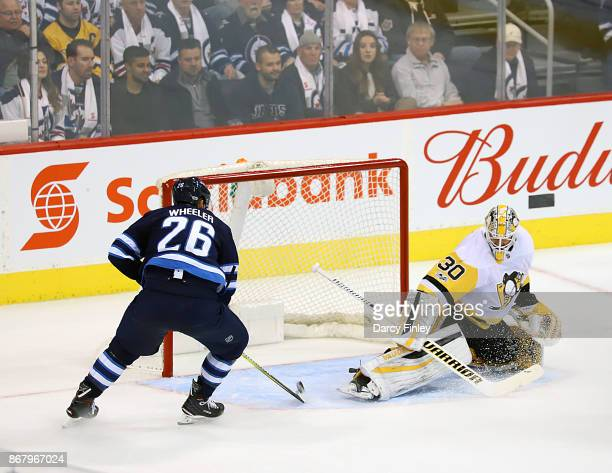 Blake Wheeler of the Winnipeg Jets redirects a puck past goaltender Matthew Murray of the Pittsburgh Penguins for a first period goal at the Bell MTS...