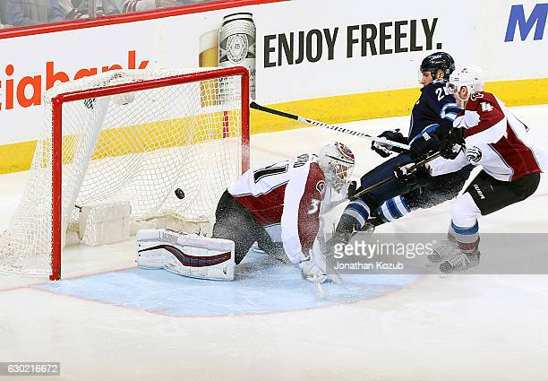 Blake Wheeler of the Winnipeg Jets redirects the puck past goaltender Calvin Packard of the Colorado Avalanche for a third period goal at the MTS...