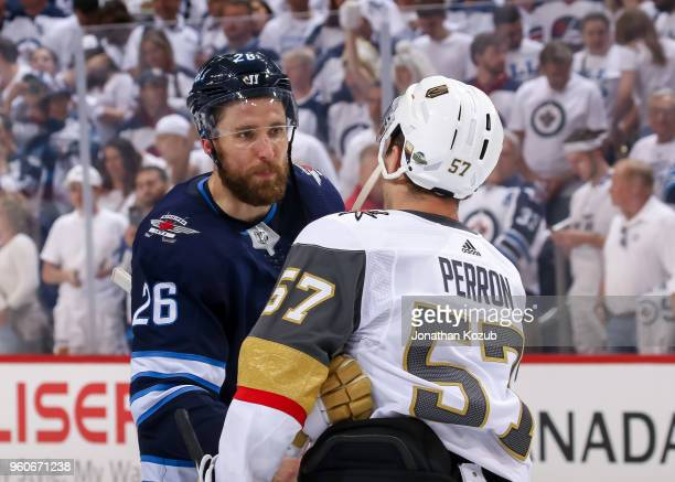 Blake Wheeler of the Winnipeg Jets shakes hands with David Perron of the Vegas Golden Knights following a 21 Knights victory in Game Five of the...