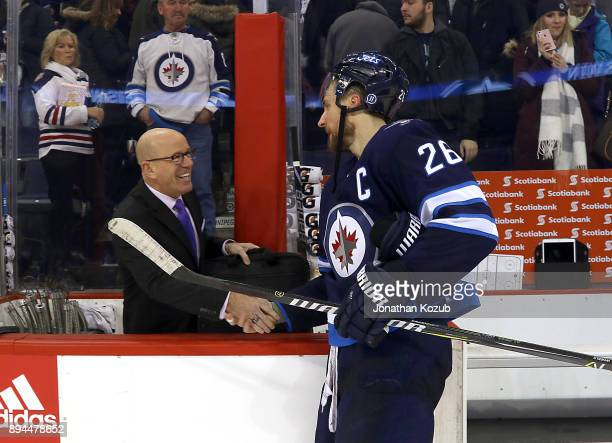 Blake Wheeler of the Winnipeg Jets shakes hands with Fox Sports Midwest color commentator Darren Pang following the Jets 40 shutout victory over the...