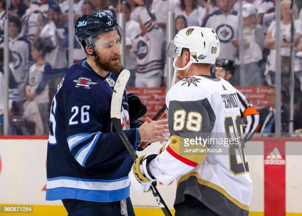 Blake Wheeler of the Winnipeg Jets shakes hands with Nate Schmidt of the Vegas Golden Knights following a 21 Knights victory in Game Five of the...