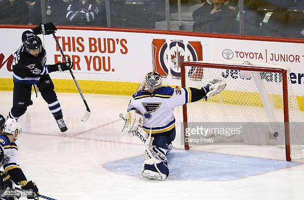 Blake Wheeler of the Winnipeg Jets shoots the puck past goaltender Pheonix Copley of the St Louis Blues for a second period goal at the MTS Centre on...