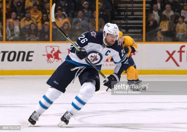 Blake Wheeler of the Winnipeg Jets skates against the Nashville Predators during the second period at Bridgestone Arena on December 19 2017 in...