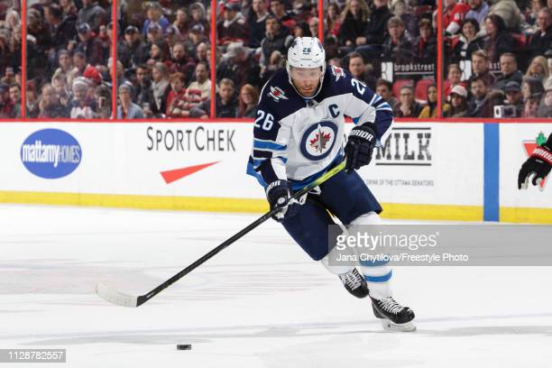 Blake Wheeler of the Winnipeg Jets skates with the puck against the Ottawa Senators at Canadian Tire Centre on February 9, 2019 in Ottawa, Ontario,...