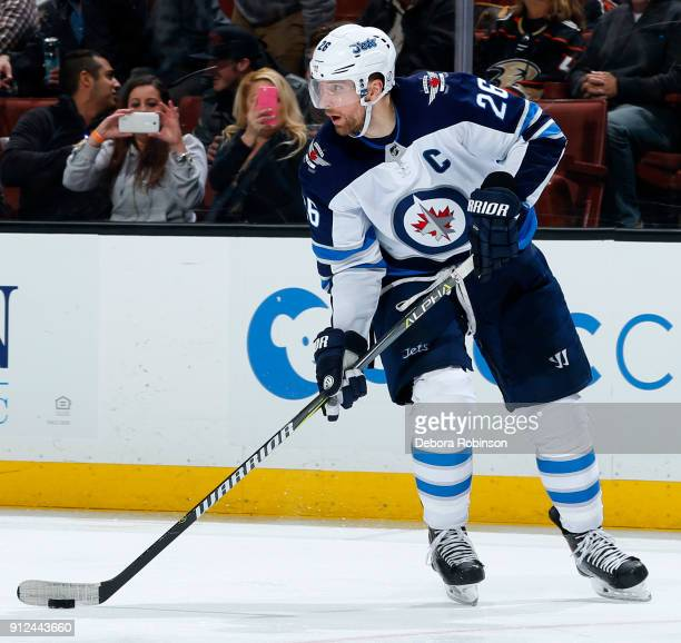 Blake Wheeler of the Winnipeg Jets skates with the puck during the game against the Anaheim Ducks on January 25 2018 at Honda Center in Anaheim...