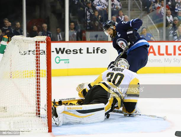 Blake Wheeler of the Winnipeg Jets sneaks the puck underneath goaltender Matthew Murray of the Pittsburgh Penguins for a first period goal at the...