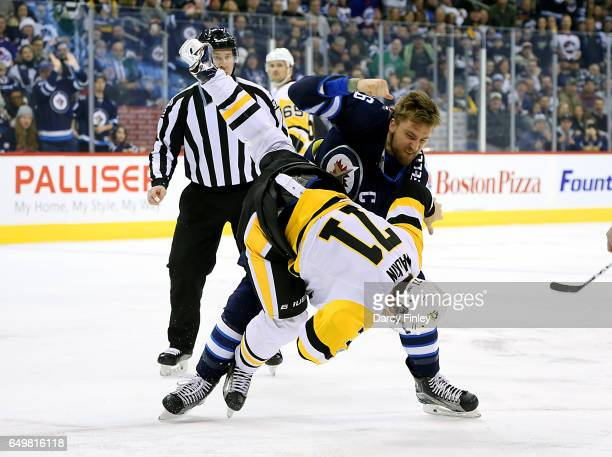 Blake Wheeler of the Winnipeg Jets takes down Evgeni Malkin of the Pittsburgh Penguins during a first period fight at the MTS Centre on March 8 2017...